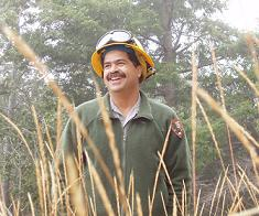Leonel Arguello describing the park's fire management program for the upland prairies and forests.